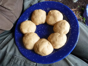 Seven little naan balls sitting on the plate, waiting to rise, don't wanna be late.