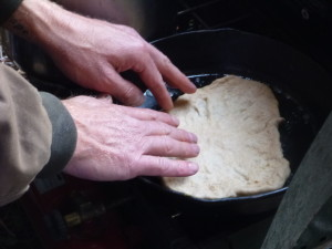 The cook carefully places the perfectly shaped dough into the skillet and hopes for the best.